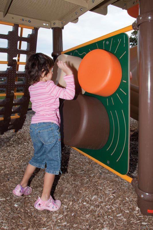 Child playing with sensory playground equipment