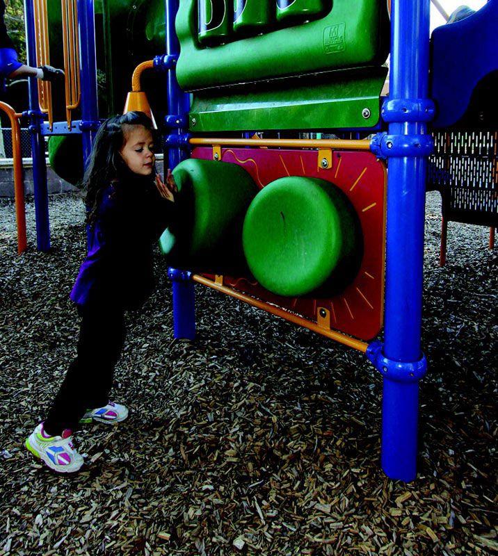 Green sensory playground wall