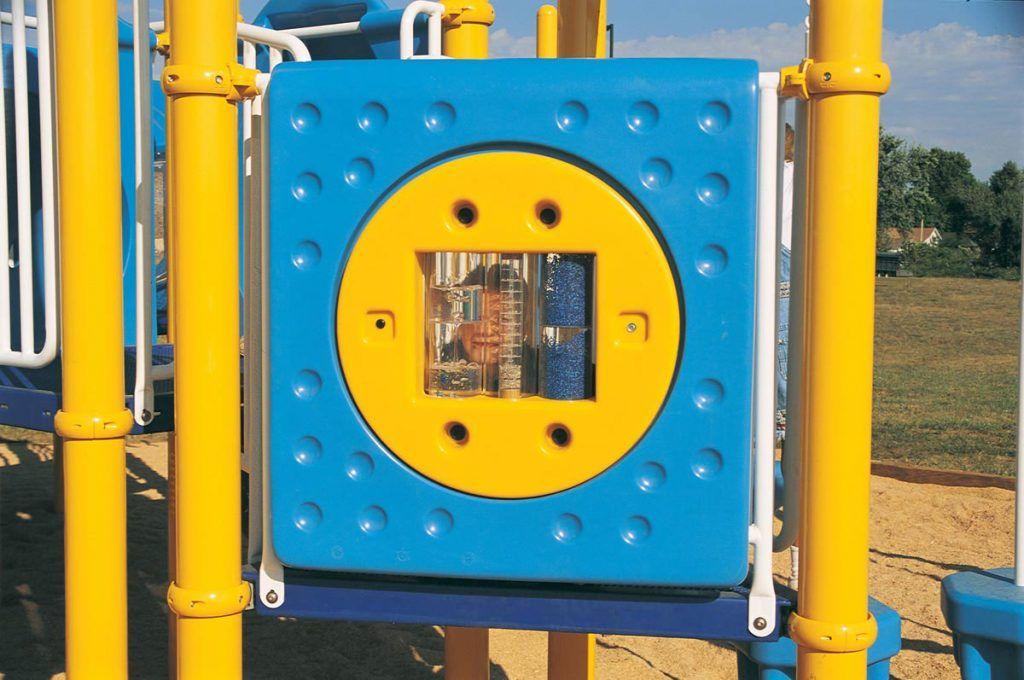 Child peeking through sensory playground equipment