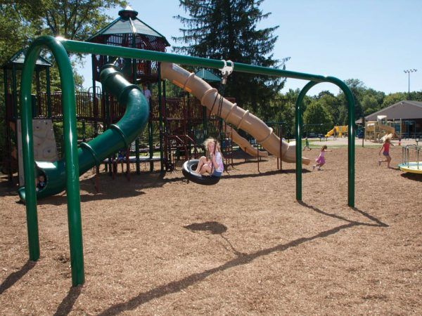 Commercial playground swing set in park