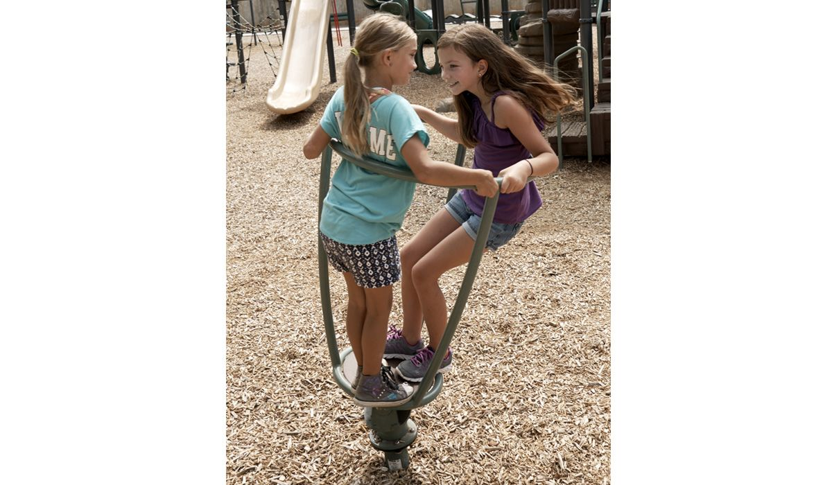 Young Girls Playing On Barrel Ride
